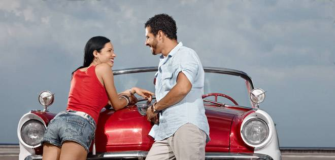 man-and-beautiful-woman-leaning-on-cabriolet-car-54f69c.jpg