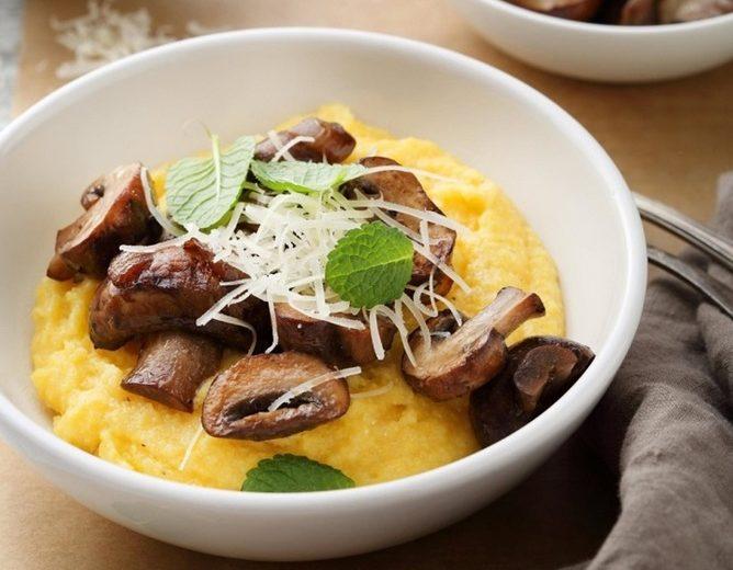 soft italian polenta in white bowl, food close-up