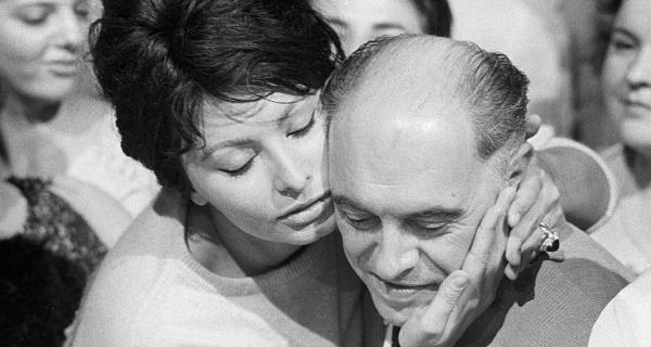 Sophia Loren kissing husband Carlo Ponti, 1950s. Photo by Pierluigi Praturlon