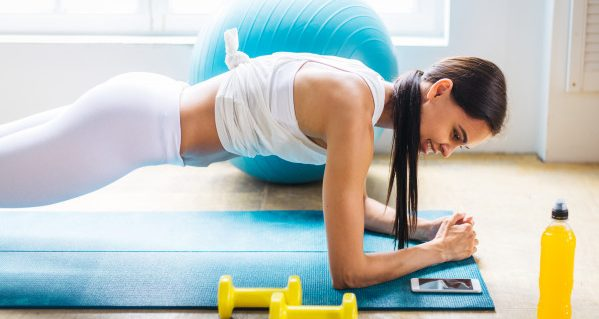 sportive-woman-training-home_186382-7676