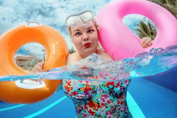 woman-relaxing-pool-beautiful-young-fat-lifebuoy-97930699