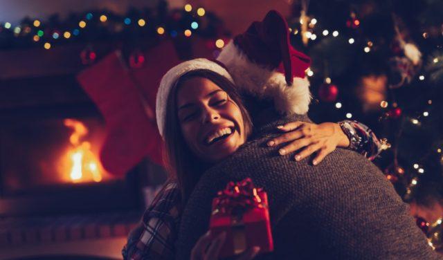 Couple exchanging Christmas presents