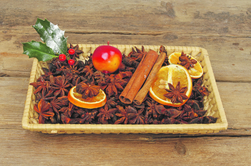 stock-photo-christmas-spice-potpourri-in-a-basket-on-old-weathered-wood-541880281_1000x0