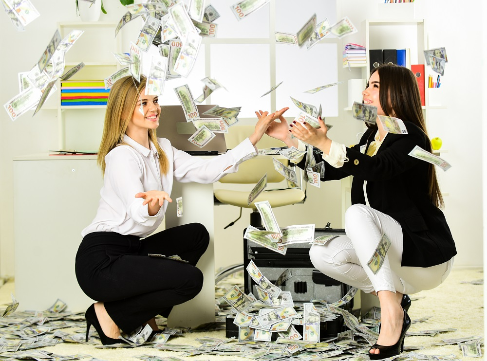 Buy franchise. Girls achieved success and financial independence. Strategies to Boost Income. Successful business. Passive income. Happy women enjoy money falling from above. Passive income