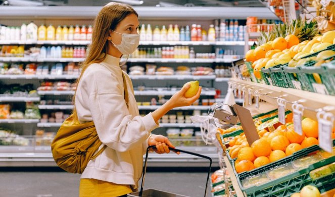 332537_woman-in-yellow-tshirt-and-beige-jacket-holding-a-fruit-3962285_f