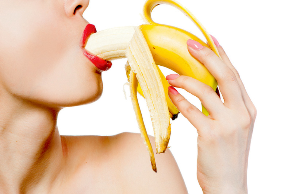 stock-photo-fgagment-female-face-with-a-banana-close-up-231018385_1000x0
