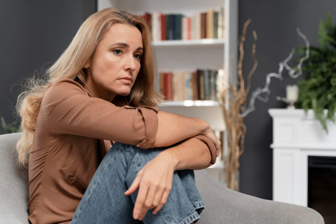 worried-woman-sitting-couch-1536x1025
