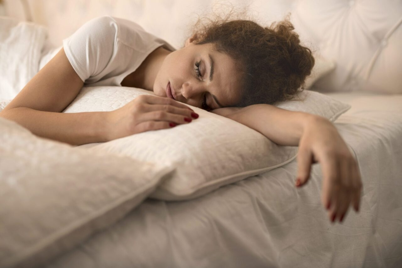 tired-woman-sleeping-in-bed