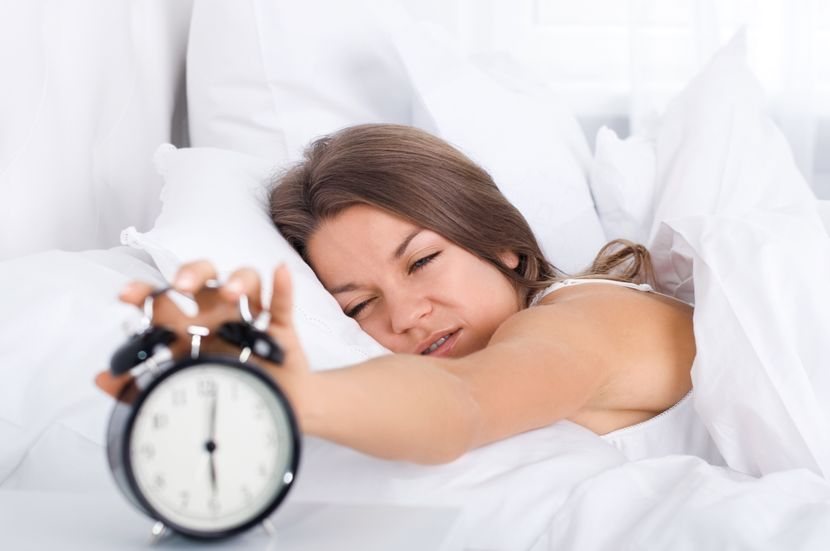 woman-bed-waking-up-830x0